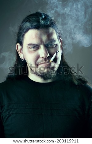Dude with flowing hair smoking