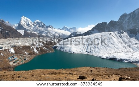 Dudh Pokhari Tso or Gokyo lake, Gokyo village, Ngozumba glacier, Arakam tse peak and chola tse peak from Gokyo Ri - trek to Cho Oyu base camp, Khumbu valley, Sagarmatha national park, Nepal