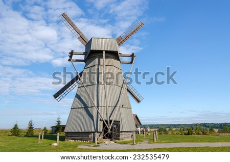 DUDUTKI, BELARUS - SEPTEMBER 6, 2014: Unidentified people  are visiting the house of the miller on excursions in Museum of vintage folk crafts and technologies in Dudutki, Belarus. Windmill - stock photo