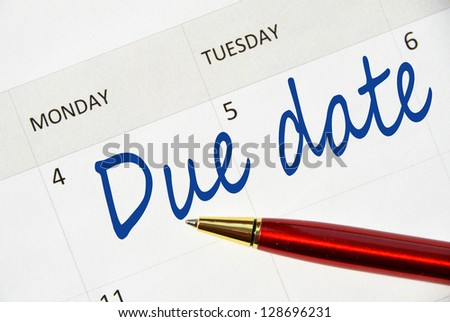 Due date note in the calendar - stock photo