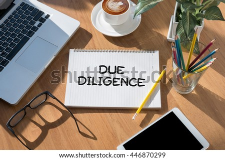 due diligence  open book on table and coffee Business - stock photo