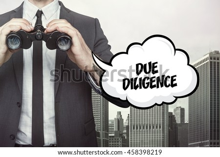 Due diligence text on speech bubble with businessman holding binoculars - stock photo