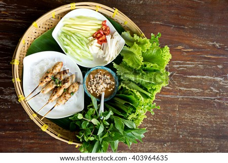 due Nham vietnam food more vegetable and grilled pork on wood table