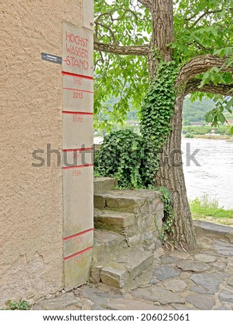 DUERNSTEIN, AUSTRIA - 16 July 2014: A building on the riverside of the Danube shows high-water level markings. - stock photo
