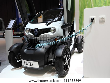 DUESSELDORF - AUGUST 27: Electric car Renault Twizy at the Caravan Salon Exhibition 2012 on August 27, 2012 in Dusseldorf, Germany - stock photo