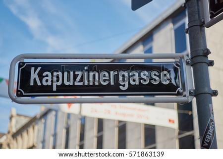 DUESSELDORF, GERMANY - AUGUST 17, 2016: A street sign indicates the famous Kapuzinergasse and provides brief explanation