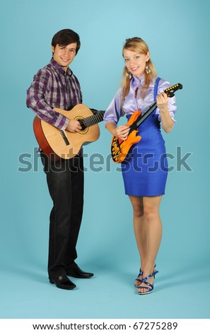 Duet playing the guitars - stock photo