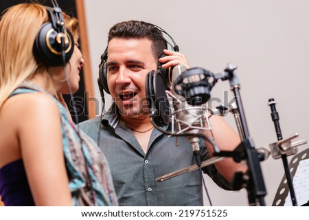 Duet singing in the recording studio - stock photo