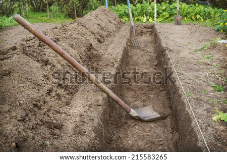 Dug a trench in the garden to make a deep bed of - stock photo