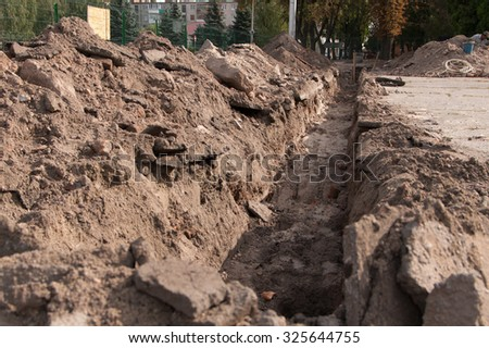 dug ditch on a construction site - stock photo