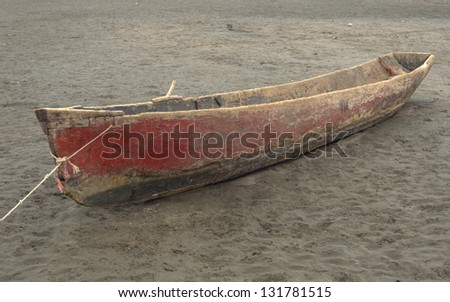 Dugout canoe on the central Pacific Coast of Nicaragua.  This boat is in use in the mangroves around La Boquitas on the central Pacific coast - stock photo