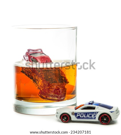 DUI concept. Image of a drunk driving accident inside a small glass with beer isolated on a white background - stock photo