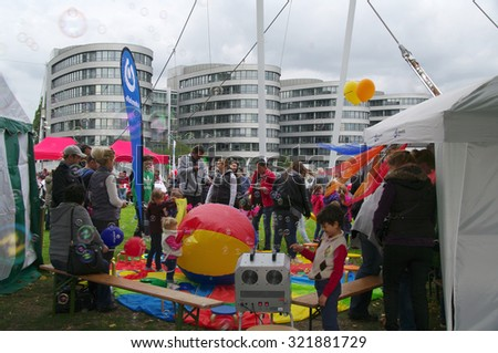 DUISBURG, GERMANY - 20.09.2015 Children's World day. Children participate in games, sweepstakes, learn new things, or just play to get gifts, sweets & souvenirs. Parents and adults help young people.