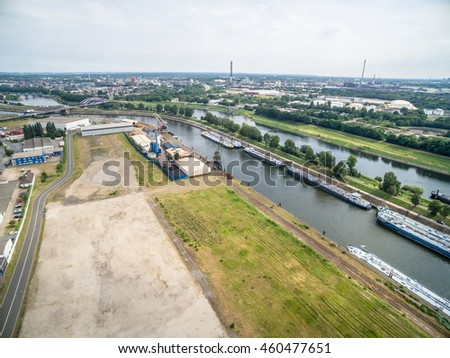 DUISBURG / GERMANY - JULY 29 2016 : Duisburg Ruhrort und the sun, aerial