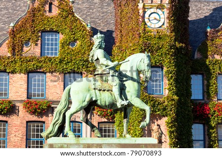 Duke Jan Wellem (Johann Wilhelm) monument in front of the townhall in Dusseldorf, Germany. The equestrian statue was erected in 1711. - stock photo
