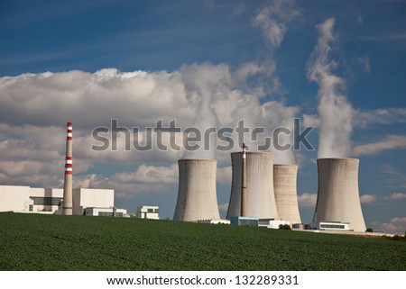 Dukovany nuclear power plant with steaming cooling towers - stock photo