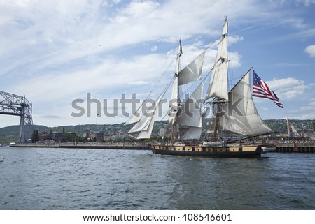DULUTH, MINNESOTA, USA - JULY 29, 2010: The brig Niagara enters Duluth harbor on Lake Superior during the Tall Ships Festival. - stock photo