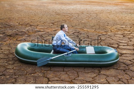 Dumb funny Business man stop on crack soil hot land desert boat businessman rock look bright future symbol crisis stagnation losses braking difficulties environmental disaster water scarcity drought - stock photo
