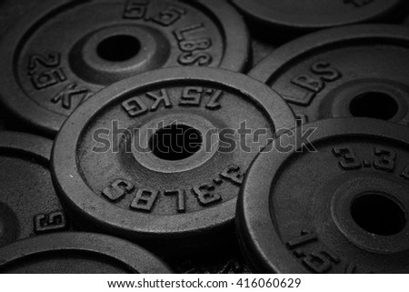 dumbbell and iron plates black and white - stock photo