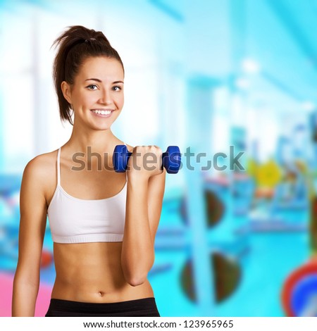 Dumbbell bicep curl by a fitness girl - stock photo
