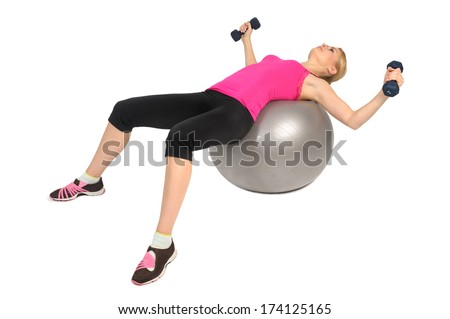 Dumbbell Chest Fly on Stability Fitness Ball Exercise, phase 1 of 2 - stock photo