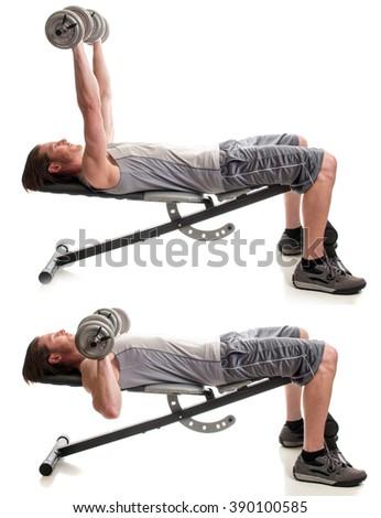 Dumbbell chest press exercise. Studio shot over white. - stock photo