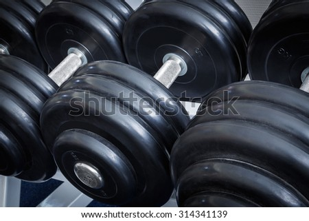 dumbbell close up in a sports club - stock photo