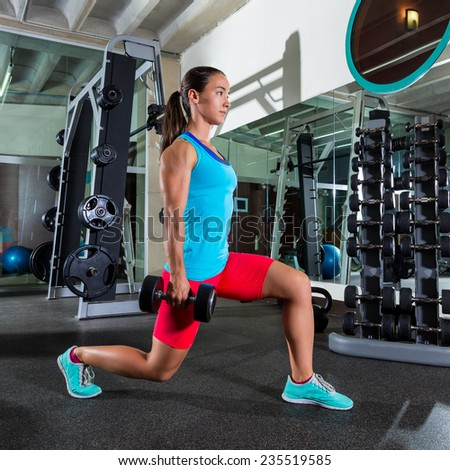 dumbbell lunge woman workout exercise at gym - stock photo