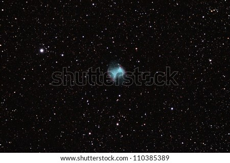 Dumbbell nebula (Messier M27 or Apple Core nebula) is a planetary nebula in the constellation of Vulpecula as seen through a 80mm refractor telescope (15min of exposure) - stock photo
