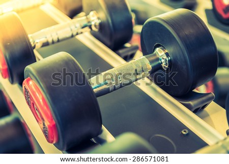 Dumbbell selective focus point - vintage filter and sun flare effect - stock photo