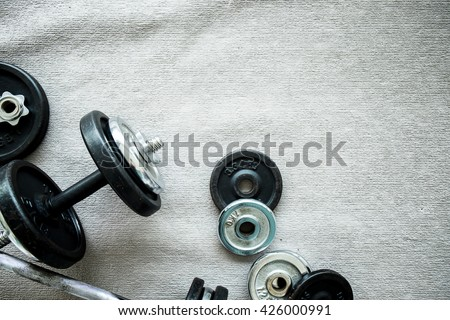 Dumbbell. Top view of dumbbell exercise weights on the floor at fitness gym with copy space. - stock photo