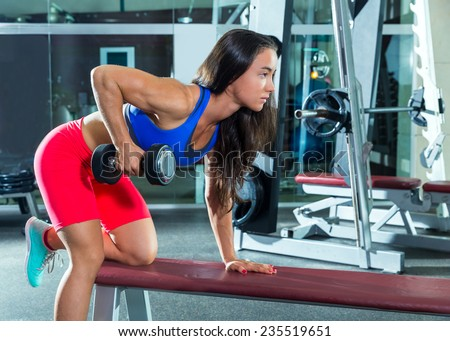 dumbbell triceps kickback girl workout exercise at gym - stock photo