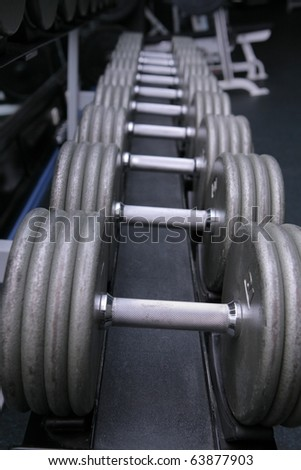 dumbbell weights in gym - stock photo