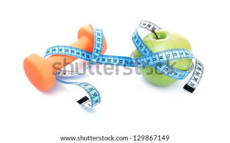 Dumbbell with apple and measure tape, isolated on white