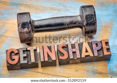 Dumbbell with get in shape text in vintage letterpress wood type - fitness concept - stock photo