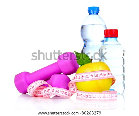 dumbbells, an apple and a bottle of water isolated on white