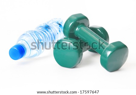 dumbbells and a bottle of water isolated on white