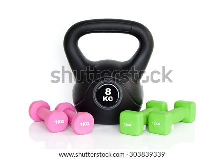 Dumbbells and kettlebell isolated on white background. Weights for a fitness training. - stock photo