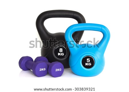 Dumbbells and kettlebells isolated on white background. Weights for a fitness training. - stock photo