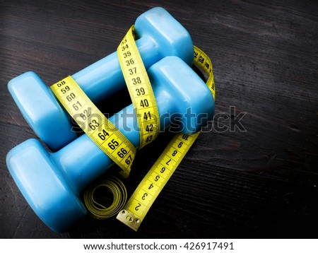 dumbbells and masure tape, diet concept  - stock photo