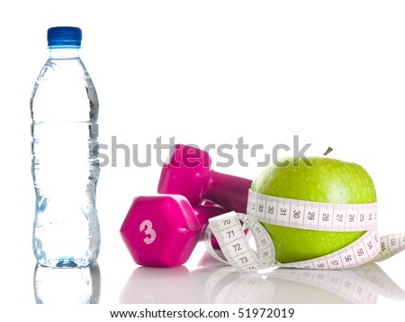 dumbbells, fresh green apple, measure tape and bottle of fresh water - stock photo