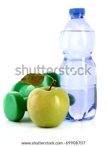 Dumbbells, green apple and water isolated on white - stock photo