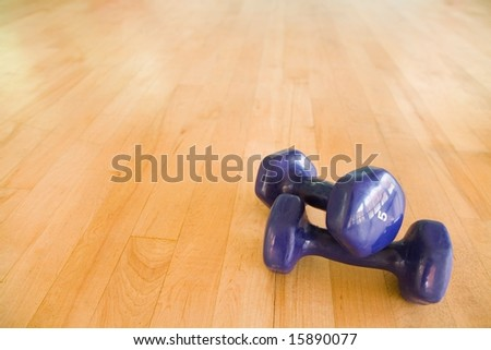 Dumbbells in gym - stock photo