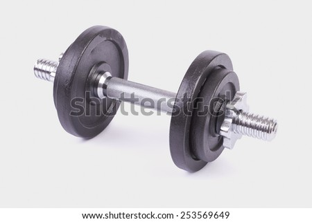 Dumbbells isolated on grey background - stock photo