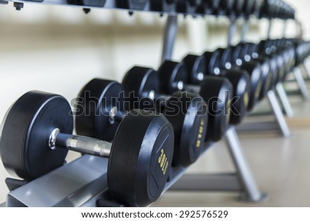 Dumbbells lined up in a fitness studio, sport gym, Shot focus - stock photo