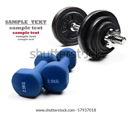 Dumbbells on a white background with space for text - stock photo