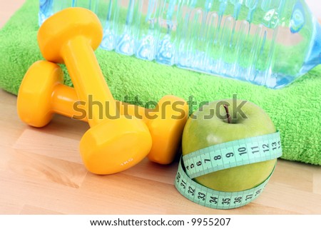 dumbbells towel and green apple - ready to fitness