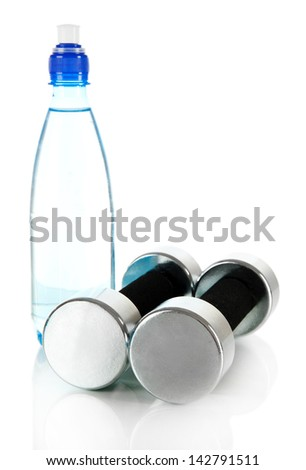 Dumbbells with bottle of water isolated on white - stock photo