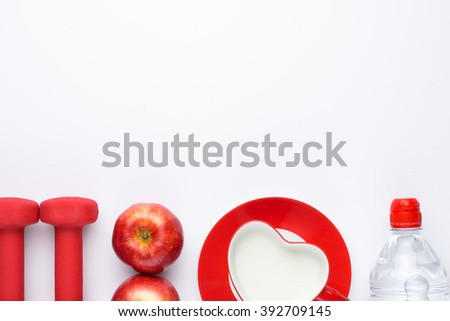 Dumbells, fresh fruits, milk and water bottle over white background. Fitness and health concept. View from above. Top view with copy space. - stock photo