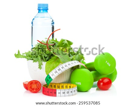 Dumbells, tape measure and healthy food. Fitness and health. Isolated on white background - stock photo